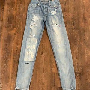 Vintage size 0 light wash jeans with design